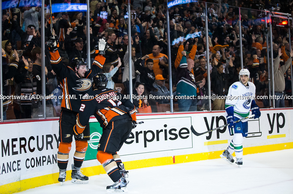 December 28, 2014 - Anaheim Ducks Defenceman Cam Fowler (4) [8426] celebrates with Anaheim Ducks Winger Devante Smith-Pelly (12) [8365] after scoring a goal in overtime, which gave the Ducks the victory over the Canucks during the game between Vancouver Canucks and Anaheim Ducks at Honda Center in Anaheim, CA. Ducks defeated Canucks in overtime 2-1.