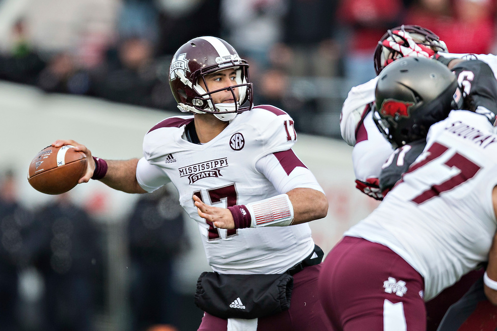 LITTLE ROCK, ARKANSAS - NOVEMBER 23:  Tyler Russell #17 of the Mississippi State Bulldogs throws a pass against the Arkansas Razorbacks at War Memorial Stadium on November 23, 2013 in Little Rock, Arkansas.  The Bulldogs defeated the Razorbacks 24-17.  (Photo by Wesley Hitt/Getty Images) *** Local Caption *** Tyler Russell