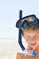 Boy (5-6 years) wearing snorkeling goggles portrait