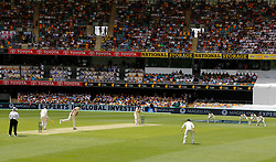 Australia's Mitchell Starc bowls the first ball during day one of the Ashes Test match at The Gabba, Brisbane.