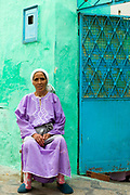 Portrait of Moroccan lady sitting outside her family home, Asilah Medina, Northern Morocco, 2015-08-11. <br />