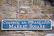 Market Square sign in Gaelic and English in quaint traditional town of Youghal, County Cork, Ireland