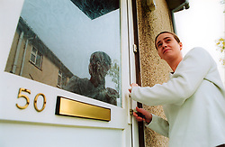 Homeless woman living in temporary accommodation; North Yorkshire, Opening the front door with her key,