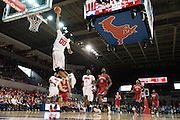 DALLAS, TX - DECEMBER 16: Ben Moore #00 of the SMU Mustangs catches an alley-oop against the Nicholls State Colonels on December 16, 2015 at Moody Coliseum in Dallas, Texas.  (Photo by Cooper Neill/Getty Images) *** Local Caption *** Ben Moore