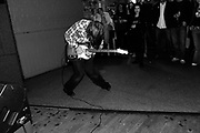 A guitarist in a band performing on the dancefloor for people, The Very Aberdeen festival, Aberdeen, Scotland, 2005
