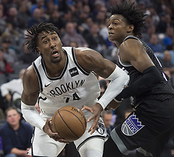 March 1, 2018 - Sacramento, CA, USA - The Brooklyn Nets' Rondae Hollis-Jefferson (24) works against the Sacramento Kings' De'Aaron Fox at the Golden 1 Center in Sacramento, Calif., on Thursday, March 1, 2018. (Credit Image: © Hector Amezcua/TNS via ZUMA Wire)