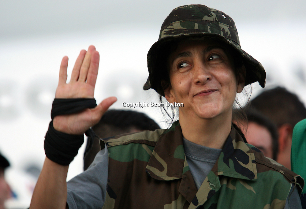 Ingrid Betancourt, who was help captive by FARC rebels for over 6 years, waves up upon her arrival to Bogotá after being rescued in a Colombian military operation on July 2, 2008. (Photo/Scott Dalton).
