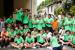 Local kids wait to cheer on the peloton at Giro Rosa 2018 - Stage 5, a 122.6 km road race starting and finishing in Omegna, Italy on July 10, 2018. Photo by Sean Robinson/velofocus.com