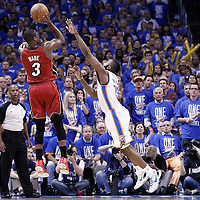 12 June 2012: Miami Heat shooting guard Dwyane Wade (3) takes a jumpshot over Oklahoma City Thunder guard James Harden (13) during the Oklahoma City Thunder 105-94 victory over the Miami Heat, in Game 1 of the 2012 NBA Finals, at the Chesapeake Energy Arena, Oklahoma City, Oklahoma, USA.