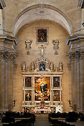 """Low angle view of interior, Church of the Purisima, Salamanca, Spain, pictured on December 19, 2010. 17th century church commissioned by Manuel de Fonseca y Ziga, as a family pantheon and convent for the seclusion of his daughter from architects Juan Gomez de Mora, Francisco de la Hoya and Antonio de Carassa. It has a Latin-cross plan roofed with barrel vaults, and a dome above the transept. Above the altar is the high reredos, by Jose de Ribera. Salamanca, an important Spanish University city, is known as La Ciudad Dorada (""""The golden city"""") because of the unique golden colour of its Renaissance sandstone buildings. Founded in 1218 its University is still one of the most important in Spain. Around it the Old Town is a UNESCO World Heritage Site. Picture by Manuel Cohen"""