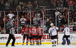 Feb 26, 2009; Newark, NJ, USA; The New Jersey Devils celebrate a goal by New Jersey Devils left wing Zach Parise (9) during the third period at the Prudential Center. The Devils defeated the Avalanche 4-0.