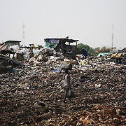 Electronic waste export to Nigeria...Olusosum dump site, Lagos.  Goverment run by the agancy Lagos Waste Management Authority ( LAWMA ). One of 6 sites taking in general waste from all over Lagos.  E-waste is not allowed on site, but some does appear from the gerneral waste  collected all over Lagos.  Scavengers,- people, are making a living out of shfting through the rubbish and selling their collections for recycling..Some of the scavengers live on site, too poor to pay for accommodation any where else. ..The shipment - TV-set originally delivered to municipality-run collecting point in UK for discarded electronic products - was tracked and monitored by Greenpeace using a combination of GPS (Global Positioning System using satellites), GSM (positioning using data from mobile networks to triangulate approximate positions) and an onboard radiofrequency transmitter (used for making triangulations in combination with handheld directional receivers used by team on ground) is placed inside the TV-set.  The TV arrived in Lagos in container no 4629416.