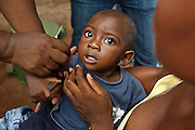 Ghana: 25 April 2012, A boy is vaccinated against measles at the Dodowa new town health outreach point in Dodowa.The GAVI Alliance is a public-private partnership that brings together developing country and donor governments, WHO, UNICEF, the World Bank, the vaccine industry in both industrialised and developing countries, research and technical agencies, civil society, the Bill & Melinda Gates Foundation and other private philanthropists.  Set up in 2000 as the Global Alliance for Vaccines and Immunisation, GAVI's mission is to save children's lives and protect people's health by increasing access to immunisation in the world's poorest countries.