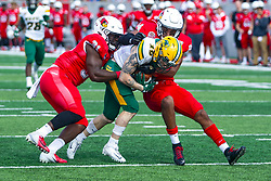 NORMAL, IL - October 05: Jimmy Kepouros keeps his legs moving, but Aaron Mends and Christian Uphoff make the stop during a college football game between the ISU (Illinois State University) Redbirds and the North Dakota State Bison on October 05 2019 at Hancock Stadium in Normal, IL. (Photo by Alan Look)
