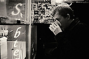 Mike of Art Majors finishing a drink while looking out from Subterranean's green room.