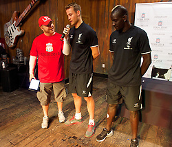 CHARLOTTE, USA - Friday, August 1, 2014: Jon Wilson interviews Liverpool's goalkeeper Simon Mignolet and Mamadou Sakho at the Whisky River bar on day twelve of the club's USA Tour. (Pic by David Rawcliffe/Propaganda)