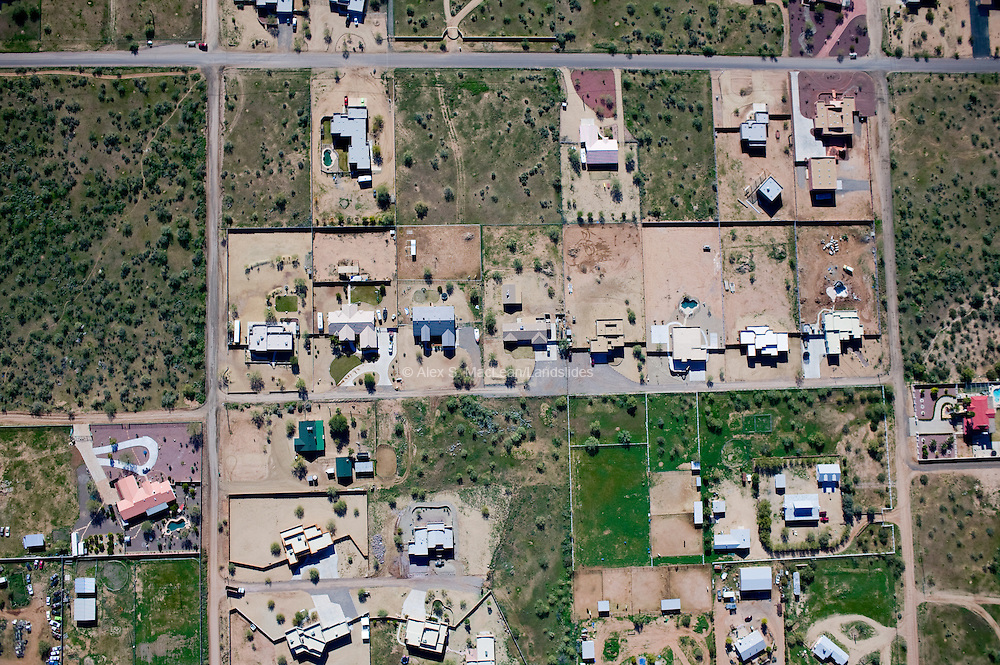 A detail from the previous page shows how the grid is divided into smaller lots for individual homes.  Most of these homes use dry landscaping, known as xeriscaping, instead of using lawns and nonnative plants, which often require large amounts of water.  Arizonans use up to 70 percent of municipal water for outdoor use.