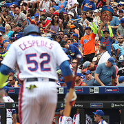 NEW YORK, NEW YORK - July 03: Yoenis Cespedes #52 of the New York Mets prepares to bat as his fans cheer wearing his green sleeve during the Chicago Cubs Vs New York Mets regular season MLB game at Citi Field on July 03, 2016 in New York City. (Photo by Tim Clayton/Corbis via Getty Images)