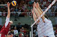 (L) Bartosz Kurek from Poland spikes during the 2013 CEV VELUX Volleyball European Championship match between Poland and France at Ergo Arena in Gdansk on September 21, 2013.<br /> <br /> Poland, Gdansk, September 21, 2013<br /> <br /> Picture also available in RAW (NEF) or TIFF format on special request.<br /> <br /> For editorial use only. Any commercial or promotional use requires permission.<br /> <br /> Mandatory credit:<br /> Photo by © Adam Nurkiewicz / Mediasport