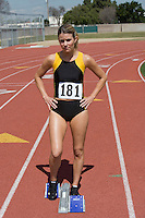 Female athlete standing in starting block
