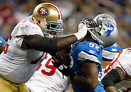 San Francisco 49ers offensive tackle Anthony Davis, left,  blocks Detroit Lions defensive end Cliff Avril, right, in the first quarter of an NFL football game in Detroit, Sunday, Oct. 16, 2011. (AP Photo/Rick Osentoski)