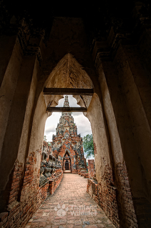 View down along the walled cloisters at Wat Chai Wattanaram at Ayuthaya World heritage site.