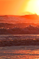 Warm orange sunrise surf at a Outer Banks beach.