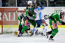 Brad Cole (HDD Tilia Olimpija, #2) high-sticking Harlan Pratt (SAPA Fehervar AV19, #41) during ice-hockey match between HDD Tilia Olimpija and SAPA Fehervar AV19 at second match in Quarterfinal  of EBEL league, on Februar 21, 2012 at Hala Tivoli, Ljubljana, Slovenia. (Photo By Matic Klansek Velej / Sportida)