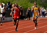 9 APRIL 2011 -- UNIVERSITY CITY, Mo. -- Hazelwood Central HIgh School runner Michael Hester (right) sprints to the finish line during the boys' 400 meter run at the Charlie Beck Invitational track meet at University City High School in University City, Mo. Saturday, April 9, 2011. Hester won the event. Image (c) copyright 2011 Sid Hastings.