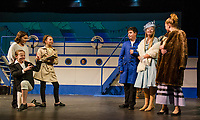 Reporters Aubrie Rubbo, Lauren Nazer with photographer Anya Arenstem as they interview Vincent Marcella as Lord Evelyn Oakleigh, Camryn Marshall as Hope Harcourt and Avery Hennig as Mrs. Harcourt before boarding the S. S. American sailing from New York to London at dress rehearsal for Anthing Goes with the Gilford Middle School on Monday.   (Karen Bobotas/for the Laconia Daily Sun)