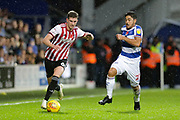 QPR midfielder Massimo Luongo (21) battles with Brentford defender Chris Mepham (6) during the EFL Sky Bet Championship match between Queens Park Rangers and Brentford at the Loftus Road Stadium, London, England on 10 November 2018.