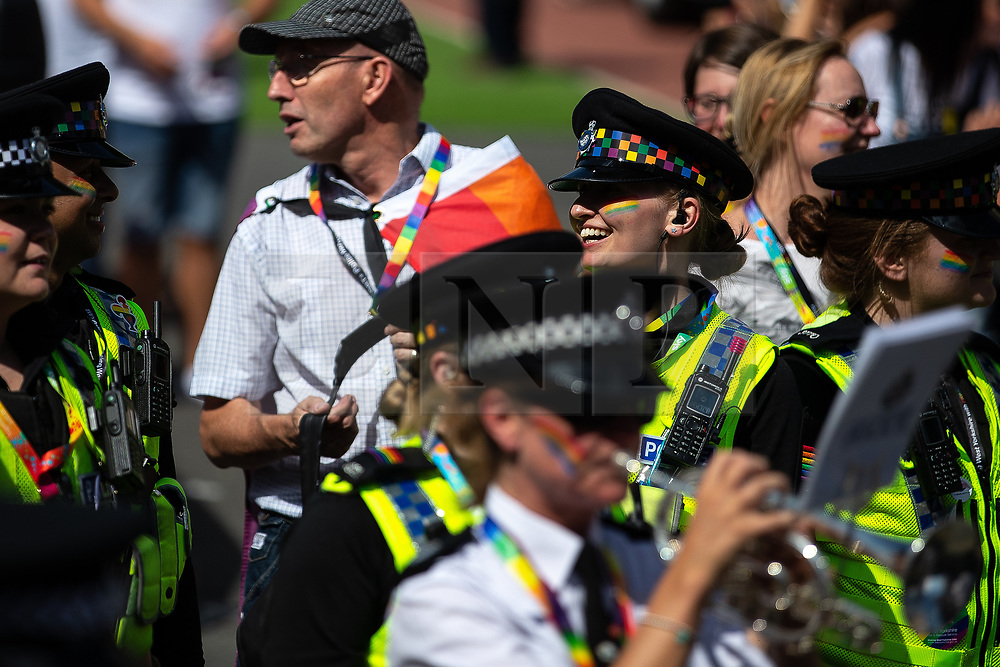 © Licensed to London News Pictures . 05/08/2018. Leeds, UK. West Yorkshire Police band plays on the parade . Leeds Gay Pride parade through the Yorkshire city's centre . Leeds's annual Gay Pride festiva celebrates the city's LGBTQ+ life and culture . Photo credit: Joel Goodman/LNP