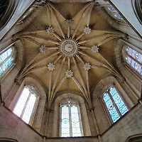 Batalha Monastery Dome in Batalha, Portugal <br /> At the top of this 106 foot dome with its elegant ribbing are ten stained glass windows that bathe the nave of the Batalha Monastery with colorful beams of sunlight.  Most of these windows date back to the 1430s, over 80 years before this church was completed.