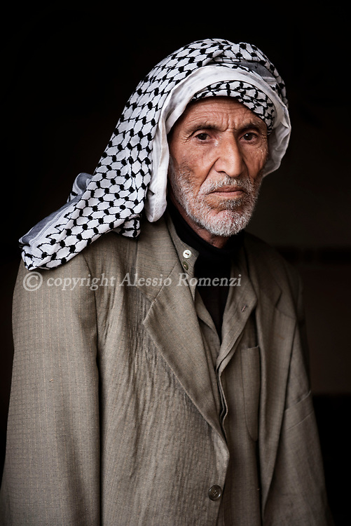 Iraq, Hamam Al Alil: Amir poses for a portrait in his house in Hamam Al Alil. <br /> His son is an ISIS fighter and he is now stigmatised by the other inhabitants of the town. Alessio Romenzi