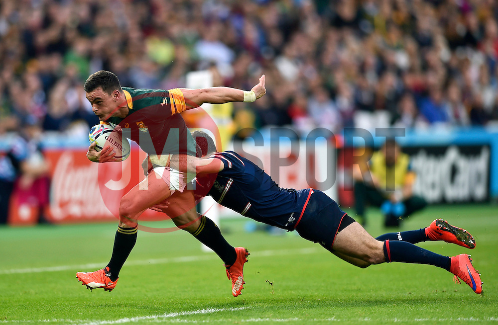 Jesse Kriel of South Africa is tackled - Mandatory byline: Patrick Khachfe/JMP - 07966 386802 - 07/10/2015 - RUGBY UNION - The Stadium, Queen Elizabeth Olympic Park - London, England - South Africa v USA - Rugby World Cup 2015 Pool B.