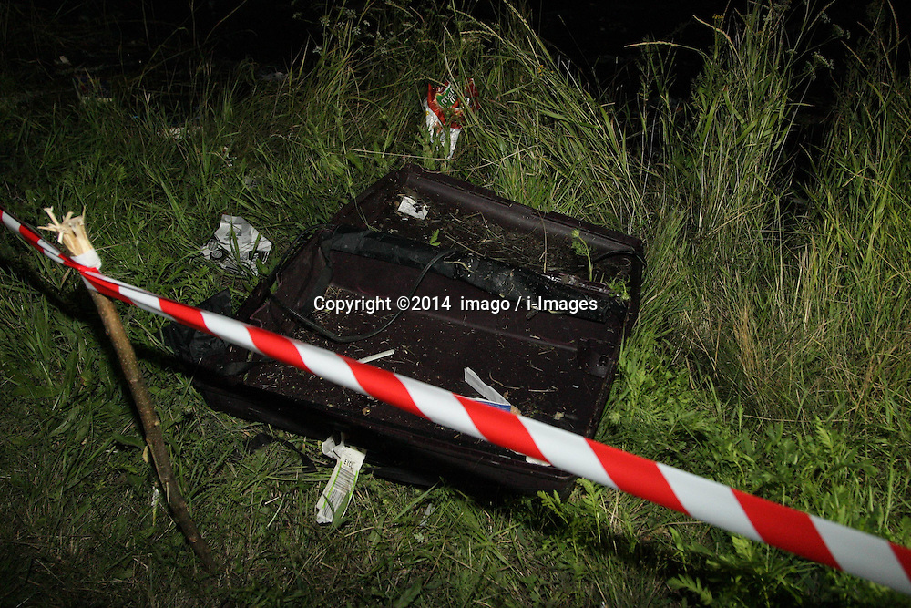 Image ©Licensed to i-Images Picture Agency. 17/07/2014.<br /> 61849951<br /> Shakhtarsk, Ukraine. The debris at the crash site of a passenger near the city of Shakhtarsk in Ukraine's Donetsk region. The crash of a Malaysian passenger plane in Ukraine on Thursday was shrouded in mystery of a deliberate attack, with Kiev trading accusations of blame with separatists and Moscow. Photo by imago / i-Images.<br /> <br /> UK ONLY