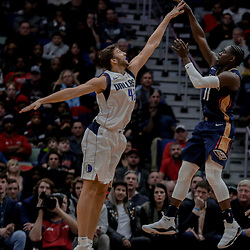 Dec 29, 2017; New Orleans, LA, USA; New Orleans Pelicans guard Jrue Holiday (11) shoots over \Dallas Mavericks forward Maximilian Kleber (42) during the second quarter at the Smoothie King Center. Mandatory Credit: Derick E. Hingle-USA TODAY Sports