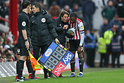 Brentford manager Thomas Frank discusses tactics with Brentford midfielder Romaine Sawyers (19) during the EFL Sky Bet Championship match between Brentford and West Bromwich Albion at Griffin Park, London, England on 16 March 2019.