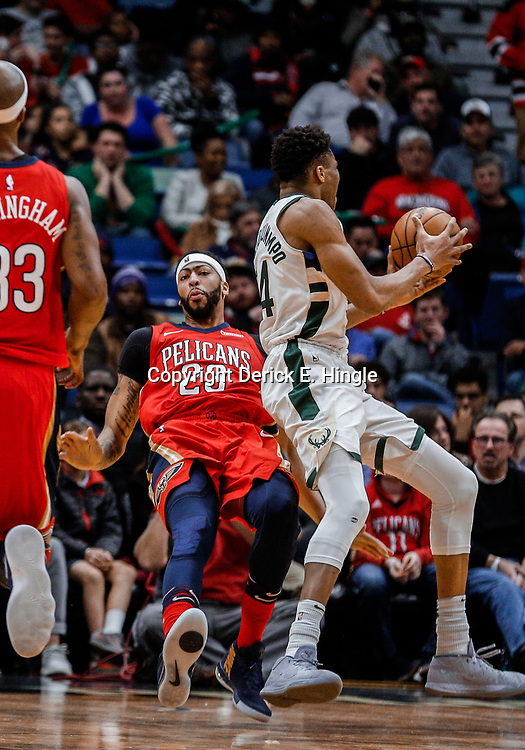 Dec 13, 2017; New Orleans, LA, USA; Milwaukee Bucks forward Giannis Antetokounmpo (34) draws a foul from New Orleans Pelicans forward Anthony Davis (23) during the second half at the Smoothie King Center. The Pelicans defeated the Bucks 115-108. Mandatory Credit: Derick E. Hingle-USA TODAY Sports