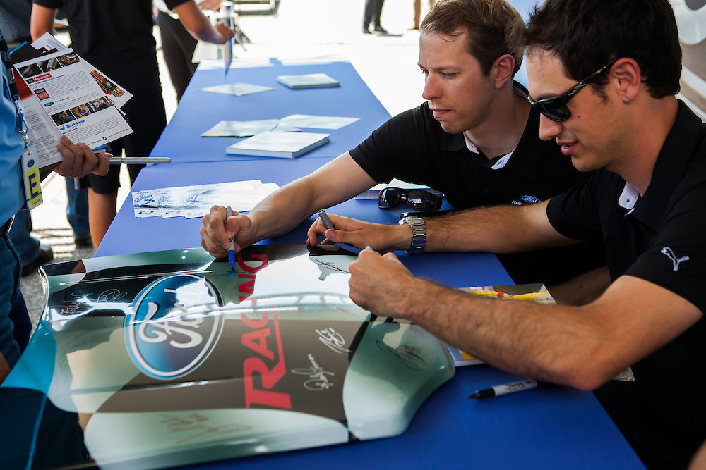 Joey Logano and Brad Keselowski sign autographs for fans at a Ford Performance event held at Ford World Headquarters.
