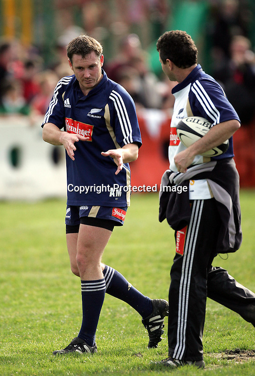 Andrew Mehrtens talks to Wayne Smith during the All Blacks training session at Silverdale United RFC, North of Auckland, New Zealand, Wednesday 7th July 2004. The All Blacks play the Pacific Islanders on Saturday.<br />
