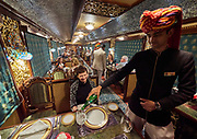India, Rajasthan. Maharajas' Express luxury train. Mayur Mahal (Peacock Palace) dining car.