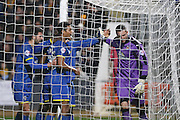 Lyle Taylor of AFC Wimbledon teases Sam Beasant (goalkeeper) of Cambridge United after his goal during the Sky Bet League 2 match between Cambridge United and AFC Wimbledon at the R Costings Abbey Stadium, Cambridge, England on 2 January 2016. Photo by Stuart Butcher.