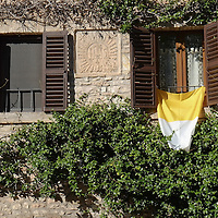 ASSISI, ITALY - OCTOBER 03:  A Vatican flag is on display in Assisi ahead of the visit of Pope Francis on October 3, 2013 in Assisi, Italy. Pope Francis is due to venerate the tomb of San Francesco of Assisi tomorrow during his one-day visit to the city.  (Photo by Marco Secchi/Getty Images)