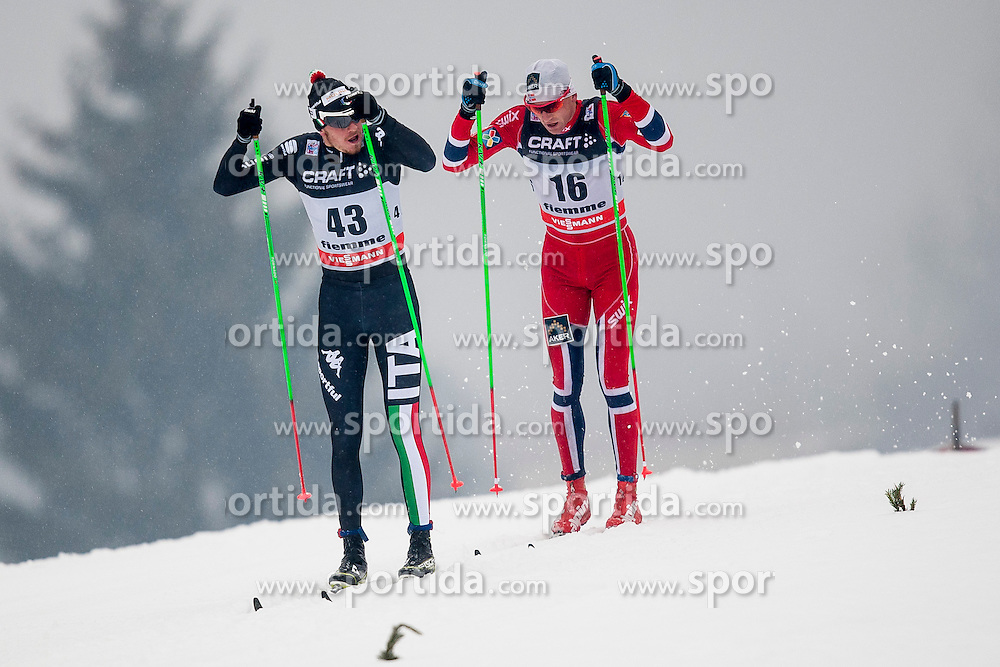 Dietmar Noeckler of Italy and Niklas Dyrhaug of Norway during mens 10km Classic individual start of the Tour de Ski 2014 of the FIS cross country World cup on January 4th, 2014 in Cross Country Centre Lago di Tesero, Val di Fiemme, Italy. (Photo by Urban Urbanc / Sportida)