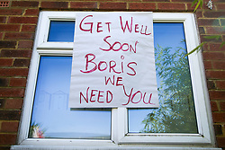 © Licensed to London News Pictures. 07/04/2020. London, UK. 'GET WELL SOON, BORIS, WE NEED YOU' sign displayed in a window of a residential property in north London. British Prime Minster Boris Johnson was admitted to the intensive care unit at St Thomas' Hospital in central London on Monday 6 April, after his conditioned worsened of COVID-19. Photo credit: Dinendra Haria/LNP