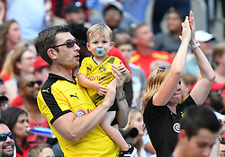 July 22, 2018 - Charlotte, NC, U.S. - CHARLOTTE, NC - JULY 22: Fans young and old cheer on the team during an International Champions Cup match between LiverPool FC and Borussia Dortmund on July 22 2018 at Bank Of America Stadium in Charlotte,NC.(Photo by Dannie Walls/Icon Sportswire) (Credit Image: © Dannie Walls/Icon SMI via ZUMA Press)