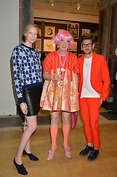 Left to right, JADE PARFITT, GRAYSON PERRY and HENRY HOLLAND at the annual Royal Academy of Art Summer Party held at Burlington House, Piccadilly, London on 4th June 2014.