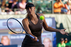 July 27, 2011; Stanford, CA, USA;  Maria Sharapova (RUS) returns the ball against Daniela Hantuchova (SVK), not pictured, during the second round of the Bank of the West Classic women's tennis tournament at the Taube Family Tennis Stadium.