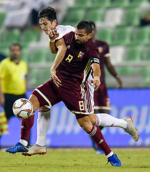 Sardar Azmoun (back) of Iran vies for the ball with Tomas Rincon (front) of Venezuela during the international friendly soccer match between Iran and Venezuela at Al Ahli Stadium Doha, Capital of Qatar, November 20, 2018. The match ended with a 1-1 draw. (Credit Image: © Nikku/Xinhua via ZUMA Wire)
